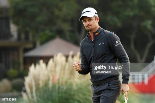 Justin Rose of England celebrates on the 18th green after finishing 14 under during the final round of the WGC HSBC Champions at Sheshan...