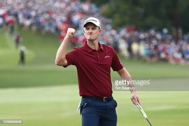 Justin Rose of England celebrates on the 18th green prior to winning the 2018 FedEx Cup during the final round of the TOUR Championship at East Lake...