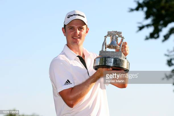 Justin Rose of England celebrates with the ATT National tournament trophy after he won the tournment following the final round of the ATT National at...
