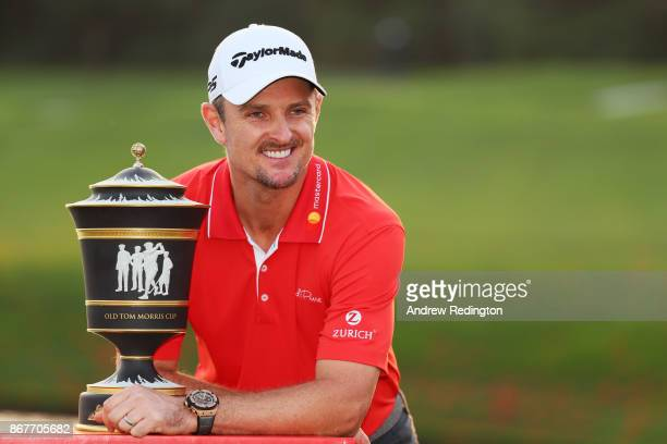 Justin Rose of England celebrates with the Old Tom Morris Cup after finishing 14 under to win the WGC HSBC Champions at Sheshan International Golf...