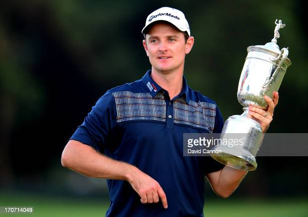 Justin Rose of England celebrates with the U.S. Open trophy after winning the 113th U.S. Open at Merion Golf Club on June 16, 2013 in Ardmore,...