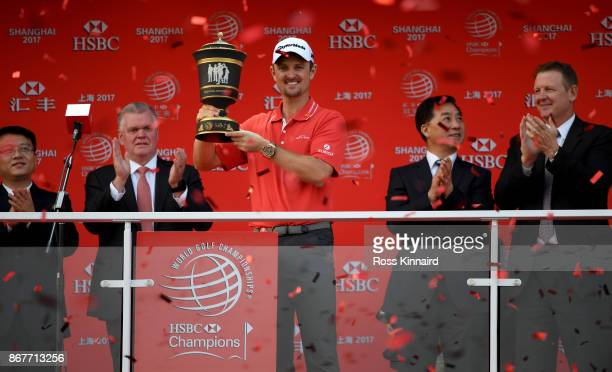 Justin Rose of England celebrates with the winners trophy after the final round of the WGC HSBC Champions at Sheshan International Golf Club on...