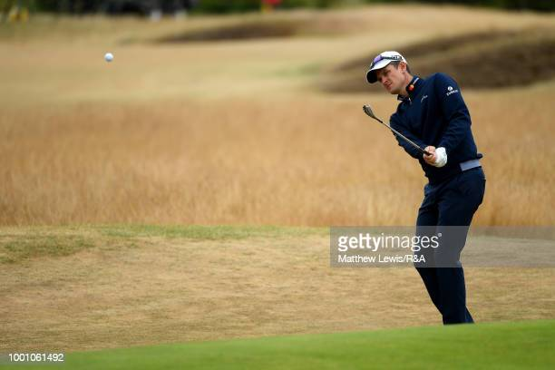 Justin Rose of England chips onto the 12th hole green while on a practice round during previews to the 147th Open Championship at Carnoustie Golf...