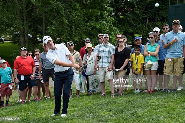 Justin Rose of England chips to the 7th green during the final round of the Memorial Tournament presented by Nationwide at Muirfield Village Golf...