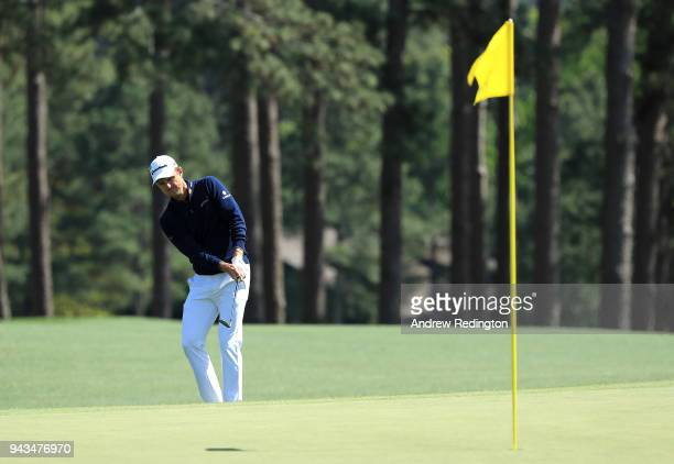 Justin Rose of England chips to the eighth green during the final round of the 2018 Masters Tournament at Augusta National Golf Club on April 8 2018...