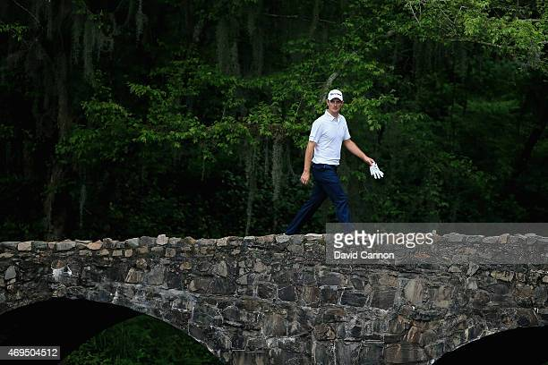 Justin Rose of England crosses the Nelson Bridge during the final round of the 2015 Masters Tournament at Augusta National Golf Club on April 12 2015...