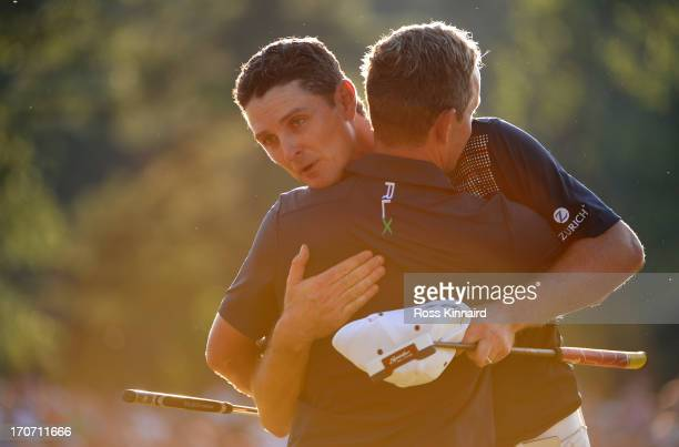 Justin Rose of England embraces caddie Mark Fulcher after putting on the 18th hole to complete the final round of the 113th U.S. Open at Merion Golf...