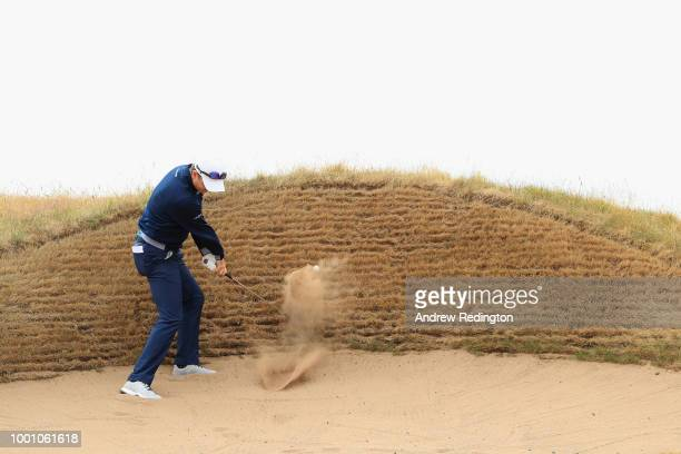Justin Rose of England hits a bunker shot on the 12th hole during previews to the 147th Open Championship at Carnoustie Golf Club on July 18 2018 in...