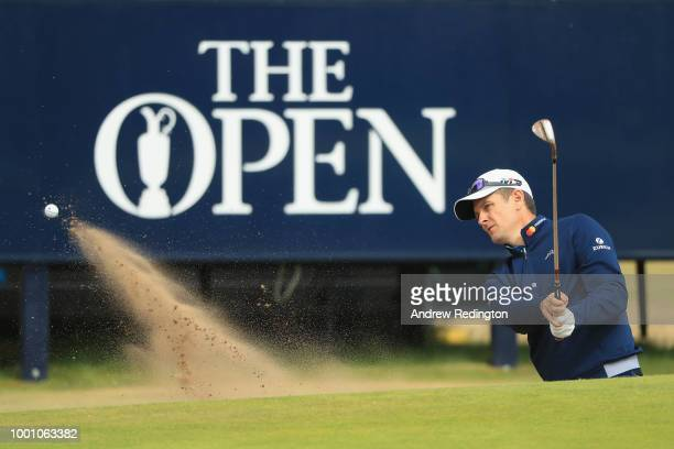 Justin Rose of England hits a bunker shot on the 13th hole during previews to the 147th Open Championship at Carnoustie Golf Club on July 18 2018 in...