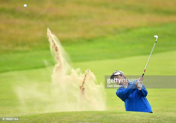 Justin Rose of England hits a bunker shot on the 5th hole during a practice round prior to the 146th Open Championship at Royal Birkdale on July 19...