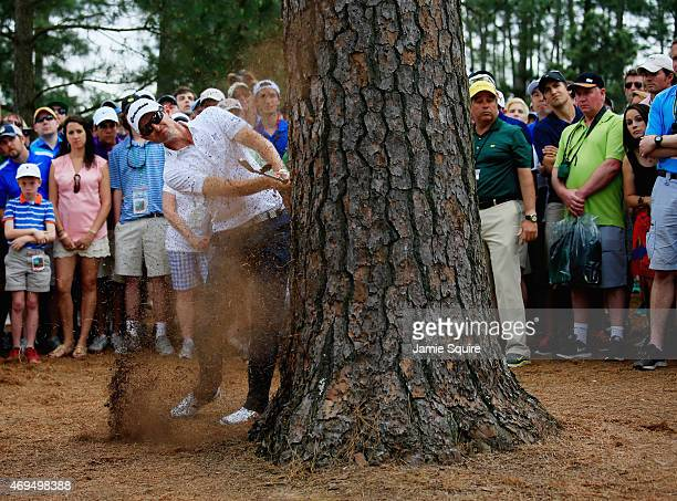 Justin Rose of England hits a shot from the pine straw on the seventh hole during the final round of the 2015 Masters Tournament at Augusta National...
