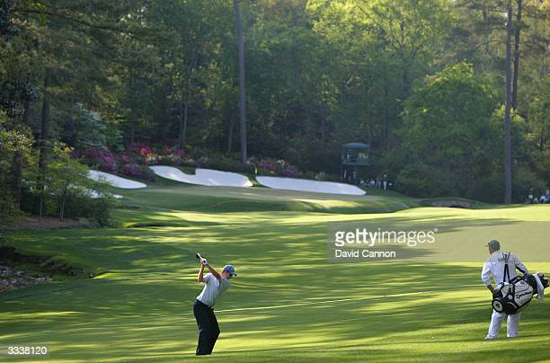 Justin Rose of England hits a shot on the 13th hole during the third round of the Masters at the Augusta National Golf Club on April 10, 2004 in...