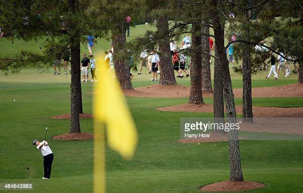 Justin Rose of England hits a shot to the seventh green during the final round of the 2014 Masters Tournament at Augusta National Golf Club on April...