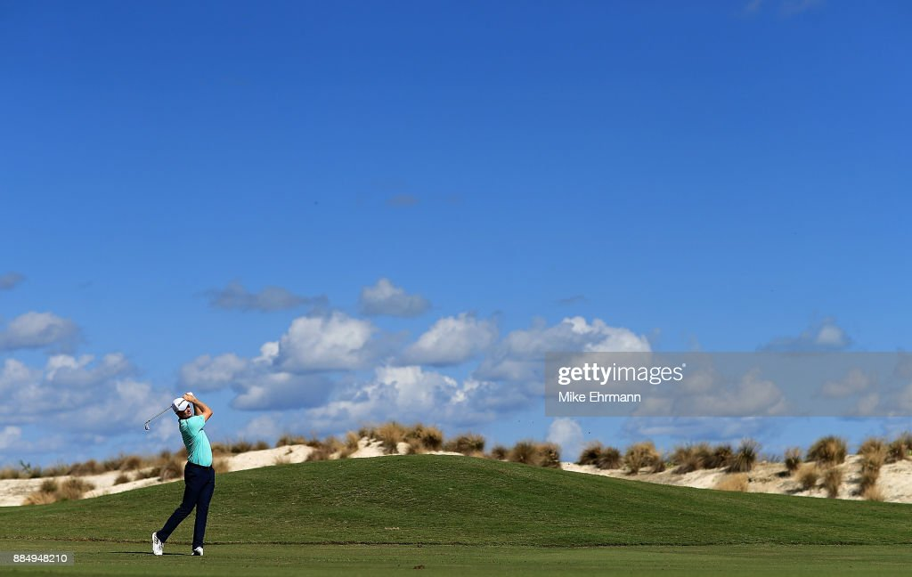 Justin Rose of England hits his approach on the fourth hole during the final round of the Hero World Challenge at Albany, Bahamas on December 3, 2017 in Nassau, Bahamas.