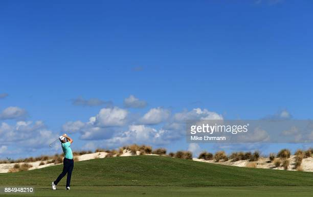Justin Rose of England hits his approach on the fourth hole during the final round of the Hero World Challenge at Albany Bahamas on December 3 2017...