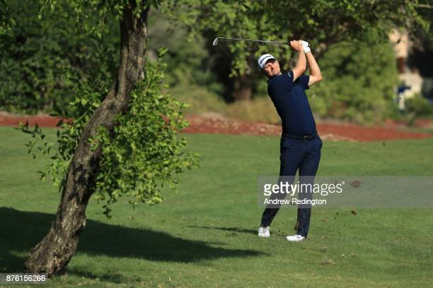 Justin Rose of England hits his second shot on the 10th hole during the final round of the DP World Tour Championship at Jumeirah Golf Estates on...