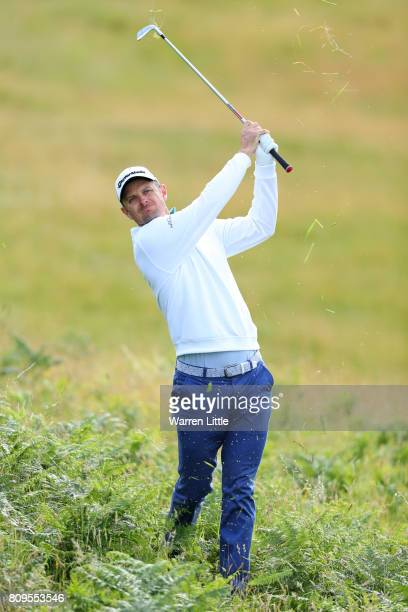 Justin Rose of England hits his second shot on the 11th hole during day one of the Dubai Duty Free Irish Open at Portstewart Golf Club on July 6,...