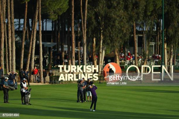 Justin Rose of England hits his second shot on the 18th hole during the final round of the Turkish Airlines Open at the Regnum Carya Golf Spa Resort...