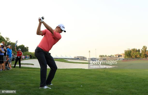 Justin Rose of England hits his second shot on the 18th hole during the first round of the DP World Tour Championship at Jumeirah Golf Estates on...