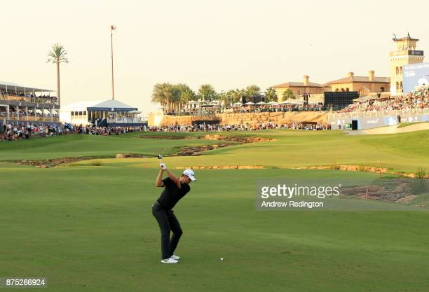 Justin Rose of England hits his second shot on the 18th hole during the second round of the DP World Tour Championship at Jumeirah Golf Estates on...