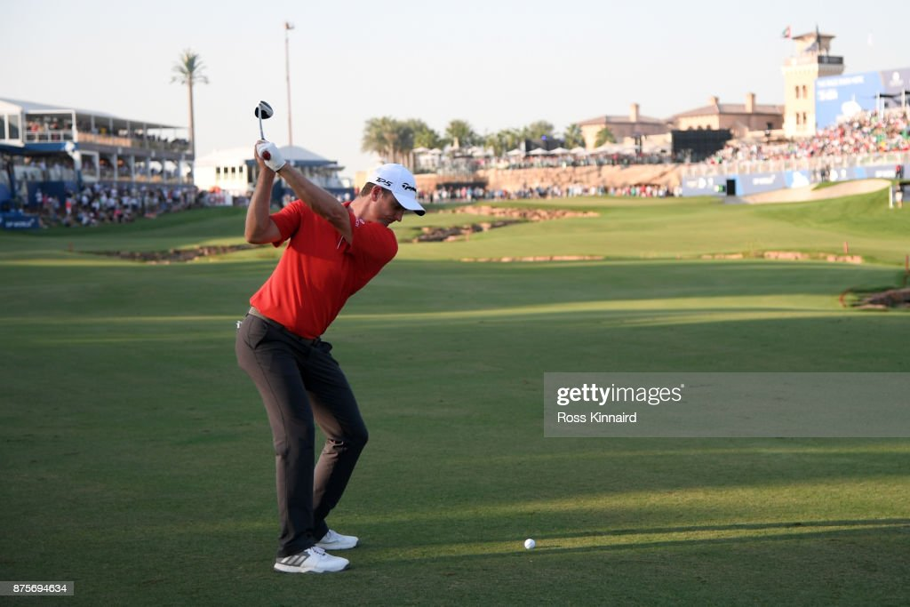 Justin Rose of England hits his second shot on the 18th hole during the third round of the DP World Tour Championship at Jumeirah Golf Estates on November 18, 2017 in Dubai, United Arab Emirates.