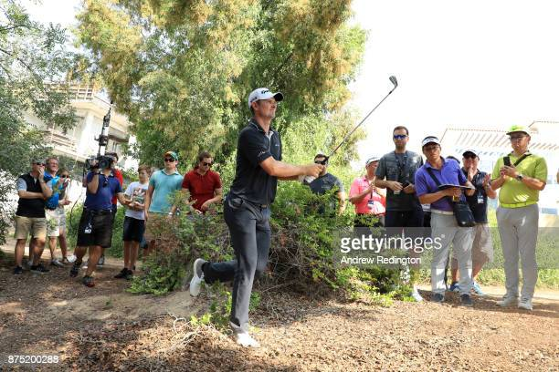 Justin Rose of England hits his second shot on the 2nd hole during the second round of the DP World Tour Championship at Jumeirah Golf Estates on...