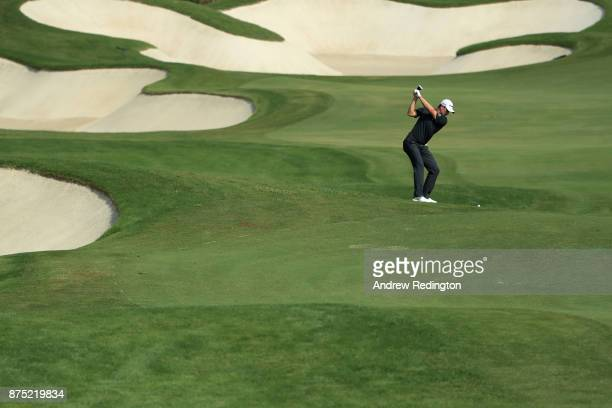 Justin Rose of England hits his second shot on the 7th hole during the second round of the DP World Tour Championship at Jumeirah Golf Estates on...