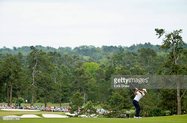 Justin Rose of England hits his second shot on the second hole during the final round of the 2015 Masters Tournament at Augusta National Golf Club on...