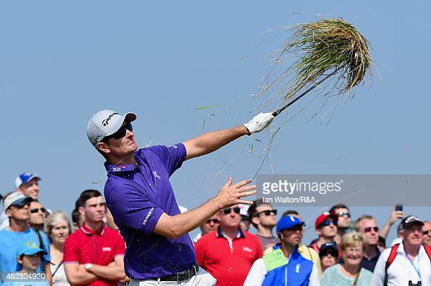 Justin Rose of England hits his second shot on the seventh hole as a gallery of spectators look on during the second round of The 143rd Open...