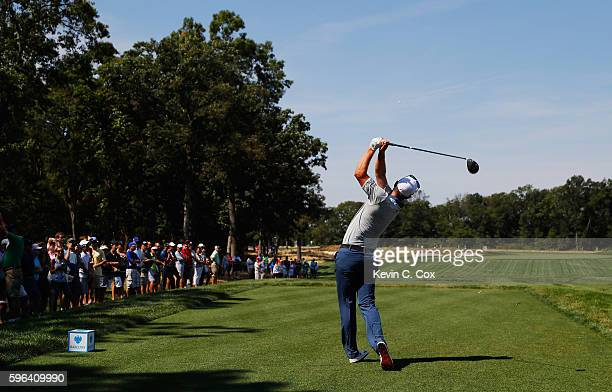 Justin Rose of England hits his tee shot on the 12th hole during the third round of The Barclays in the PGA Tour FedExCup PlayOffs on the Black...