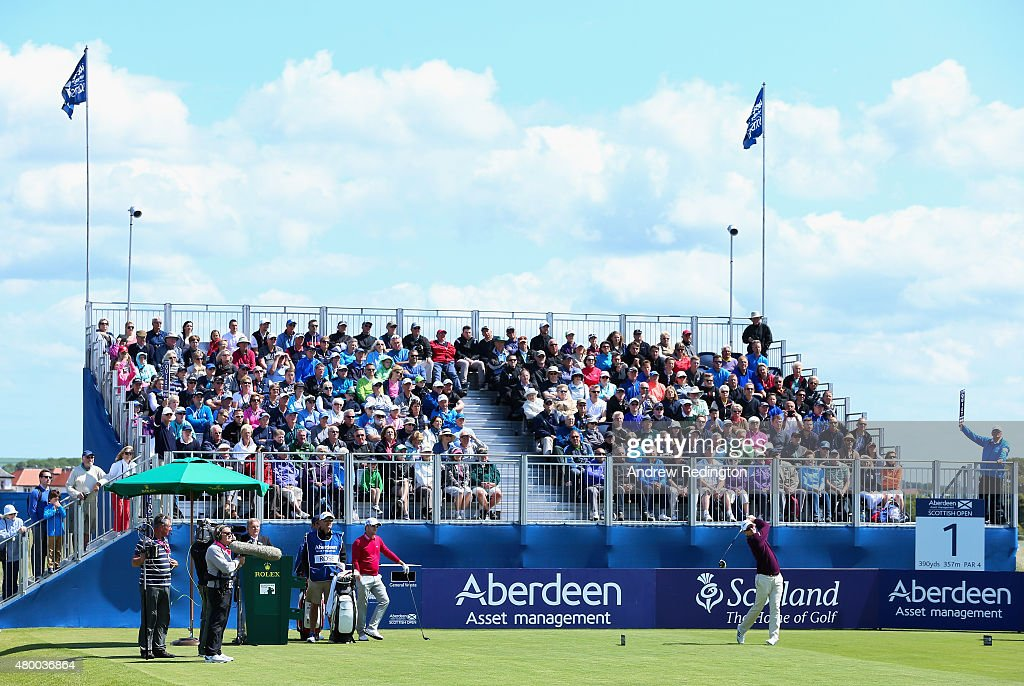 Justin Rose of England hits his tee shot on the first hole as a grandstand of fans look on during the first round of the Aberdeen Asset Management Scottish Open at Gullane Golf Club on July 9, 2015 in Gullane, East Lothian, Scotland.