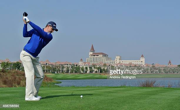 Justin Rose of England hits his tee-shot on the ninth hole during the final round of the BMW Masters at Lake Malaren Golf Club on November 2, 2014 in...