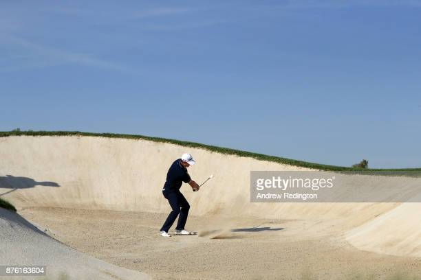 Justin Rose of England hits his third shot on the 12th hole during the final round of the DP World Tour Championship at Jumeirah Golf Estates on...