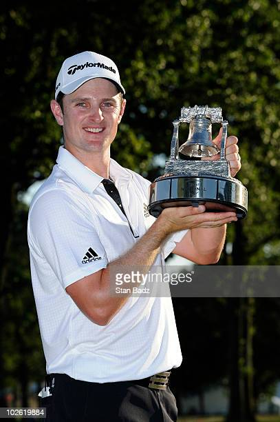 Justin Rose of England holds the champion's trophy after his win at the AT&T National at Aronimink Golf Club on July 4, 2010 in Newtown Square,...