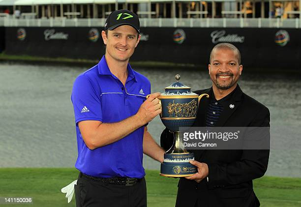 Justin Rose of England holds the Gene Sarazen Cup awarded to the winner with Don Butler the VP Marketing for Cadillac after the final round of the...