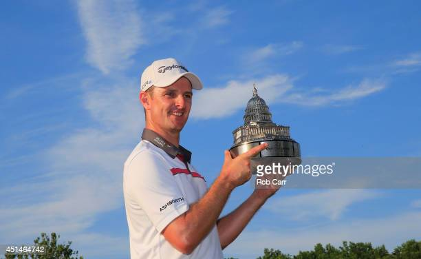 Justin Rose of England holds the trophy after winning the Quicken Loans National at Congressional Country Club on June 29 2014 in Bethesda Maryland