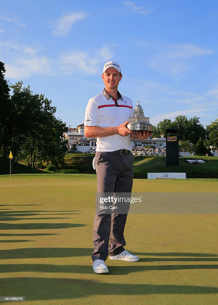 Justin Rose of England holds the trophy after winning the Quicken Loans National at Congressional Country Club on June 29, 2014 in Bethesda, Maryland.