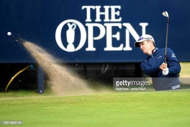 Justin Rose of England in a bunker at the 13th green while playing in a practice round during previews to the 147th Open Championship at Carnoustie...