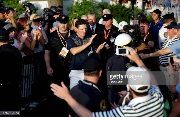 Justin Rose of England is congratulated as he walks to the trophy presentation after winning the 113th U.S. Open at Merion Golf Club on June 16, 2013...