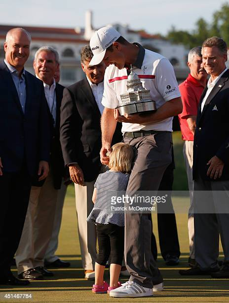 Justin Rose of England is hugged by his daughter Charlotte after winning the Quicken Loans National at Congressional Country Club on June 29 2014 in...
