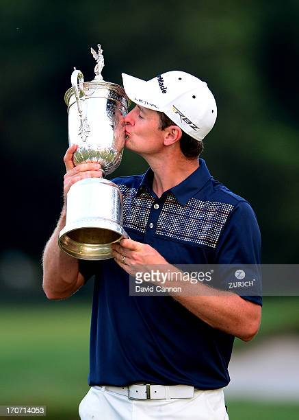 Justin Rose of England kisses the U.S. Open trophy after winning the 113th U.S. Open at Merion Golf Club on June 16, 2013 in Ardmore, Pennsylvania.