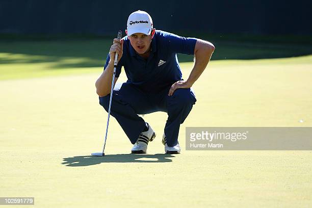 Justin Rose of England lines up a putt 18th green during the second round of the AT&T National at Aronimink Golf Club on July 2, 2010 in Newtown...