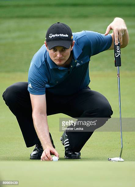 Justin Rose of England lines up a putt during the first round of the Wyndham Championship at Sedgefield Country Club on August 20, 2009 in...