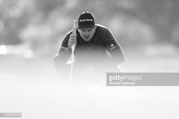 Justin Rose of England lines up a putt on the 12th green during the first round of the Arnold Palmer Invitational Presented by Mastercard at the Bay...