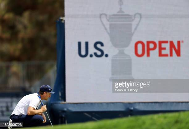 Justin Rose of England lines up a putt on the 17th hole during a practice round prior to the start of the 2021 U.S. Open at Torrey Pines Golf Course...