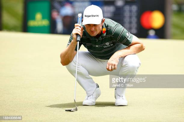 Justin Rose of England lines up a putt on the 18th green during the final round of the Wyndham Championship at Sedgefield Country Club on August 15,...