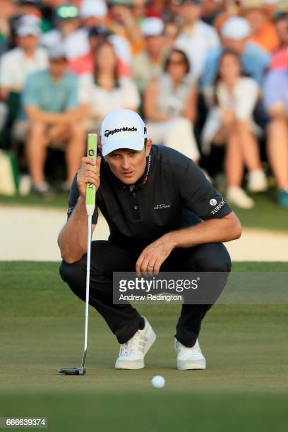 Justin Rose of England lines up his putt on the first playoff hole during the final round of the 2017 Masters Tournament at Augusta National Golf...