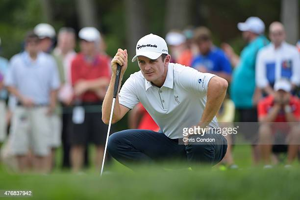 Justin Rose of England lines ups putt on the 7th green during the final round of the Memorial Tournament presented by Nationwide at Muirfield Village...