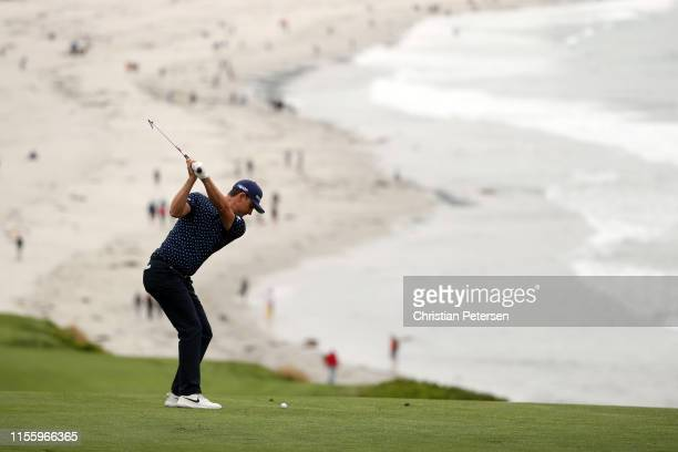 Justin Rose of England plays a second shot on the ninth hole during the second round of the 2019 U.S. Open at Pebble Beach Golf Links on June 14,...