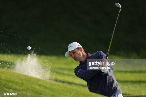 Justin Rose of England plays a shot during a practice round for The PLAYERS Championship on The Stadium Course at TPC Sawgrass on March 13 2019 in...